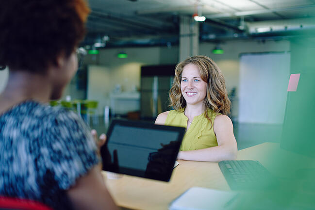 Woman smiling at coworker
