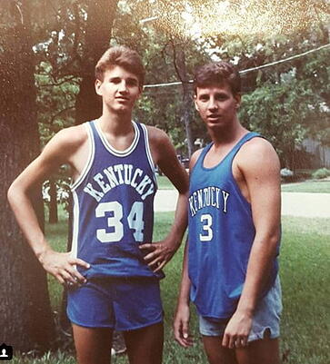 Young Dwight Cooper and friend in basketball uniform